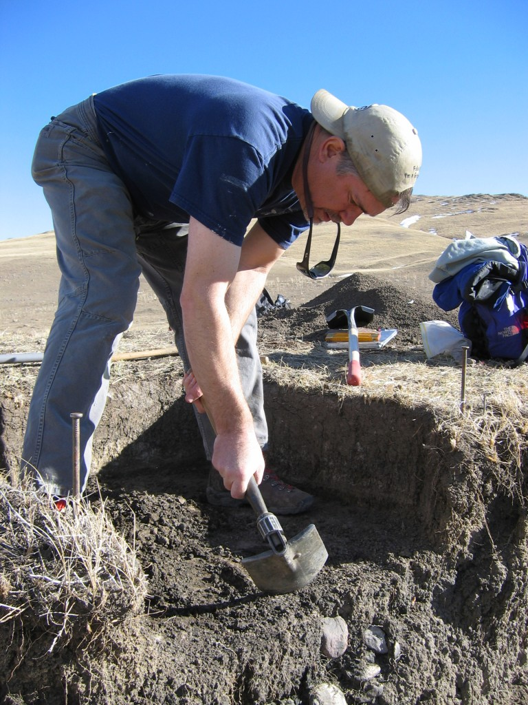 Dr. Kevin Gilmore, Ph.D., Registered Professional Archaeologist (RPA) carefully excavates the hearth feature. Kevin served as the principal investigator on the Zaharias-Thomas property.